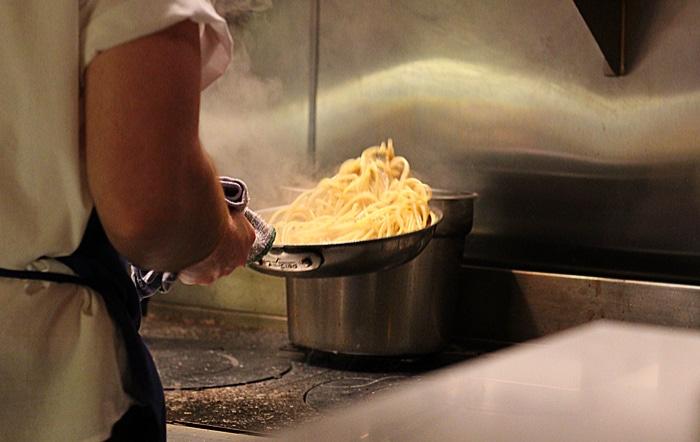 tossing pasta